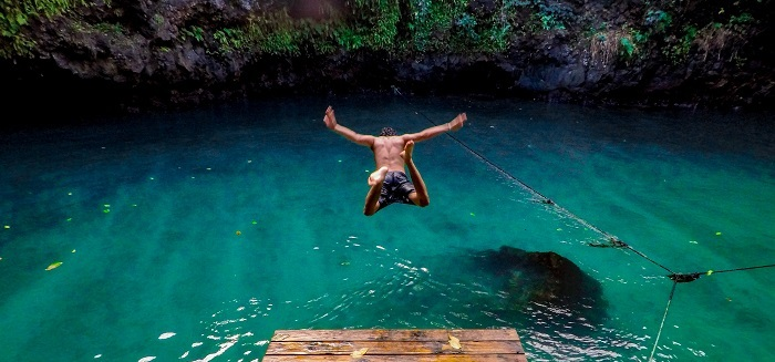 Man jumping headfirst into tropical lagoon