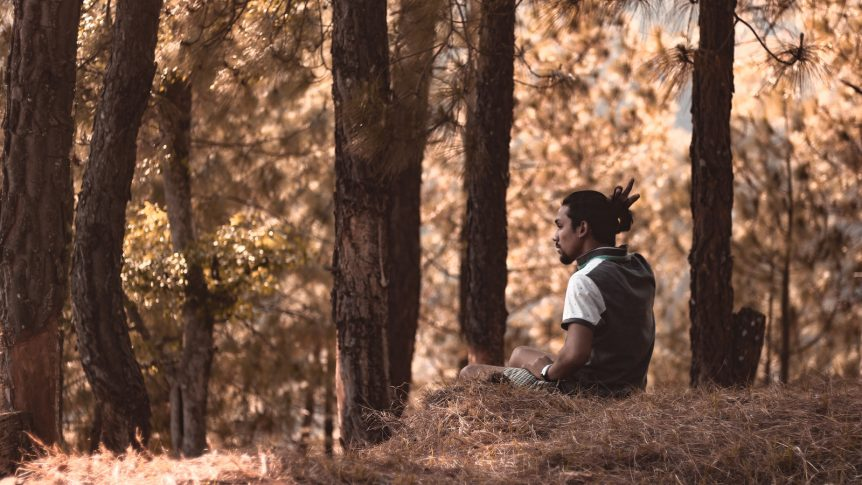 man resting in forest