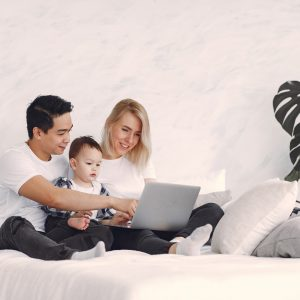 parents and child with computer